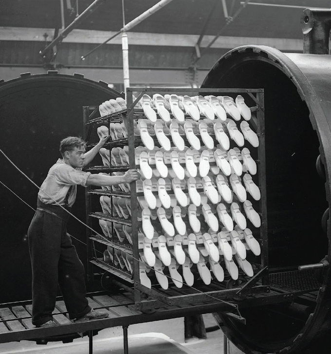 A production line at Dunlop's rubber shoe factory in Liverpool.